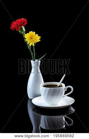 Composition With Cup Of Coffee, Yellow Chrysanthemum And Red Carnation On A Black Reflective Backgro