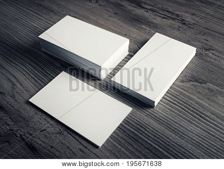 Photo of blank business cards on a wood table background. Template for ID. Business cards mockup.