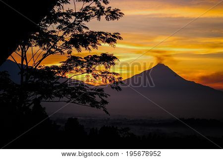 Merapi volcano in central Java during sunrise seen from Nirvana point