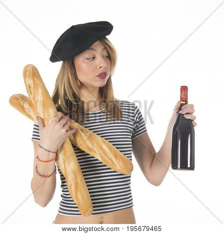 Young French girl with typical French barret and striped shirt bread and a bottle of wine isolated over white background