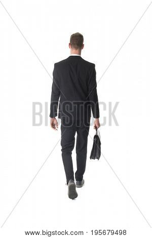Back view business man walking with briefcase isolated over white background