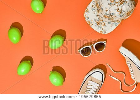 Fashion Summer Hipster Accessories Set. Lemon Citrus fruit, Trendy Sneakers, Cap, fashion Sunglasses on Orange. Hot Summer Sunny Vibes. Creative Bright Style. Vanilla Color. Surreal, Minimal, Art
