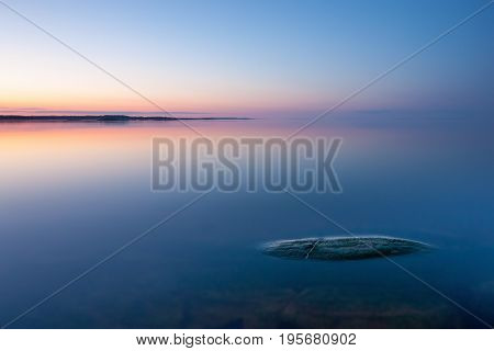 Tranquil Minimalist Landscape With Rock In Calm Water
