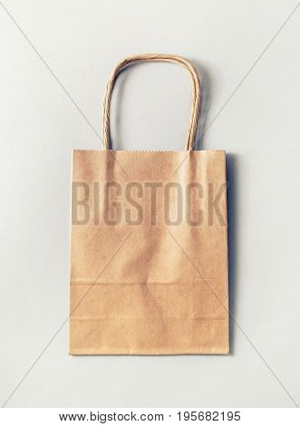 Recycled paper shopping bag on paper background.