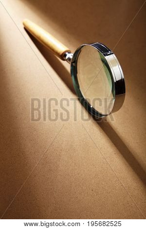 magnifier glass on the brown table top