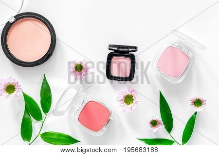 Cosmetics. Blush and eyeshadow on white table background top view.