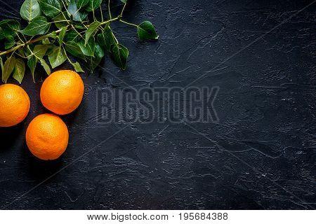 Citrus concept. Fresh oranges on black table background top view.