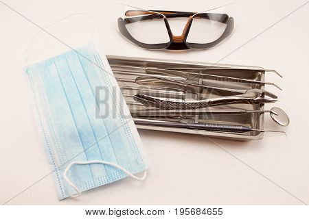 Group of dental tools in medical tray. Isolated on white background.