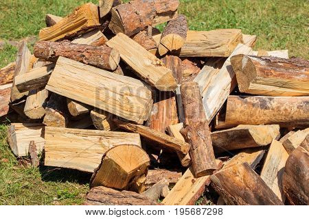 Pile of dry fire-wood for prepared for heating in winter