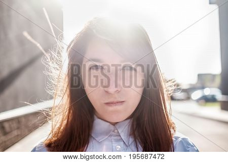 Grumpy stubborn young woman with long hair blowing cheeks and pouting while feeling mad. Human emotions, feelings, attitude, reaction