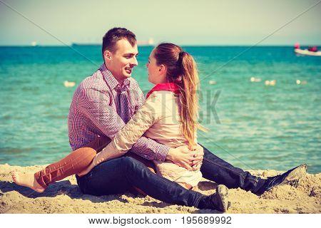 Romance beautiful relantionship concept. Happy couple having date on beach near sea.