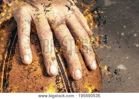 fragment of a basketball ball in a hand fire illustration.