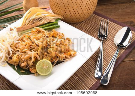 Thai Fried Noodles Pad Thai with shrimps or prawns.street food. fried noodles with chicken and shrimp