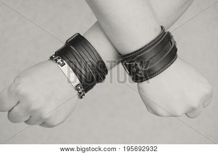 Modern fashionable leather and metal bracelets on the wrist