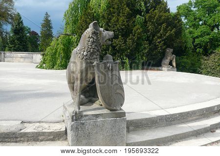 LEDNICE, CZECH REPUBLIC - MAY 13, 2017: Two lions with shields in park of Lednice Castle
