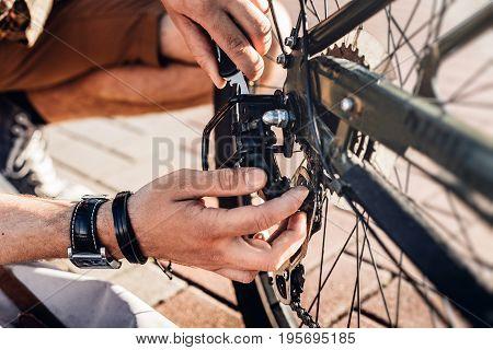Closeup Cyclist Man Hand Repairing Bicycle Wheel And Break