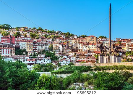 VELIKO TARNOVO BULGARIA - JULY 06 2012: View of the part of the ancient Bulgarian capital Veliko Tarnovo and the monument to the kings of the Asen dynasty.