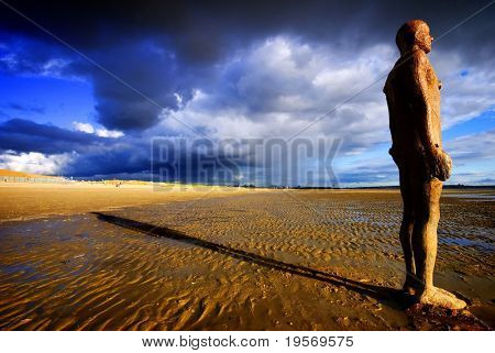 'Another Place' beach scene in Northern England