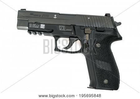Loei, Thailand - JULY 10, 2016: A 9mm Sigsauer P226 MK25 semi-automatic handgun used by both police and military on white background