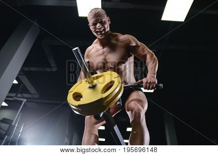 Caucasian Handsome Fitness Model Training In The Gym. Man On Diet Flexing Muscles