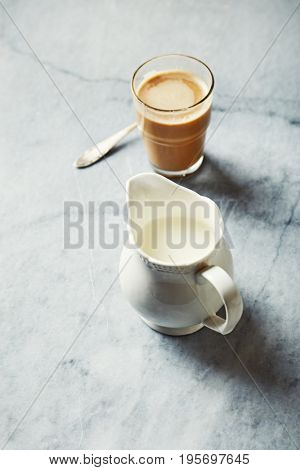 Jug of Milk and a Glass of Milk Coffee