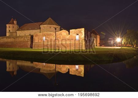 Fagaras old medieval citadel at night. Transylvania Romania Europe