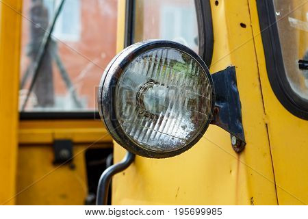 Old Yellow Forklift Truck Front Headlight Closeup