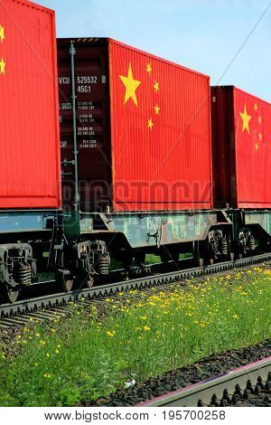 Train Freight transportation. Cargo transit. Summer Day. Container textured by flag of the China