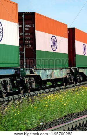 Train Freight transportation. Cargo transit. Summer Day. Container textured by flag of the India