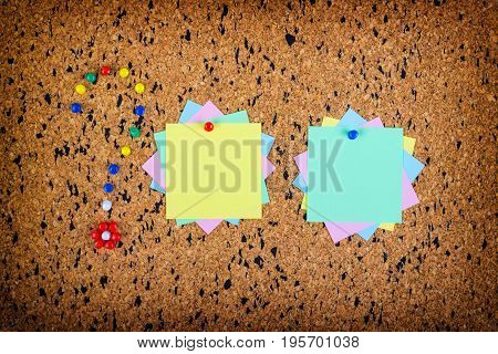 colorful sticky notes on cork bulletin board. Question mark made of pushpins