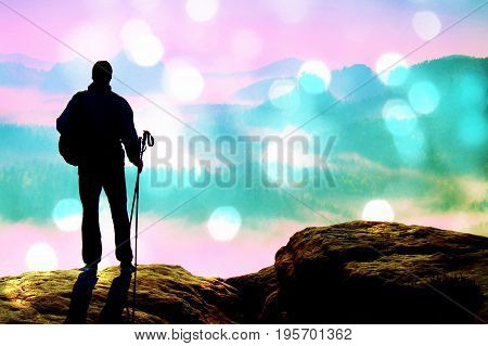 Film Grain. Silhouette Of Tourist With Poles In Hand. Sunny Spring Daybreak In Rocky Mountains. Hike