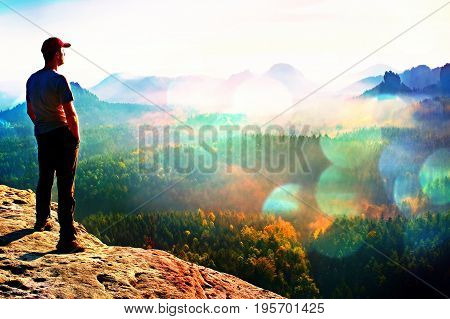 Film Grain. Hiker Is Standing On The Peak Of Sandstone Rock In Rock Empires Park And Watching Over T
