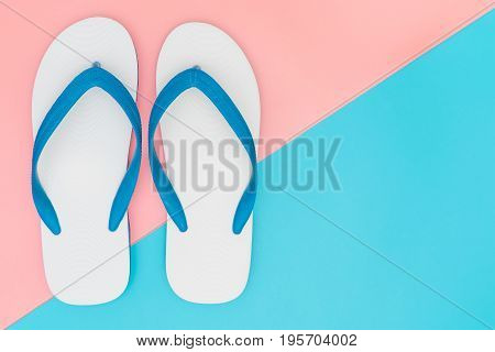 White Foam Beach Sandals on pink and blue copy space