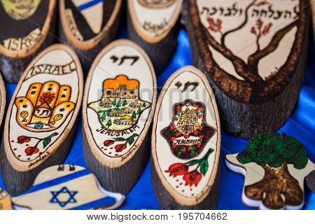TEL-AVIV, ISRAEL - JULY 07, 2017: Painted wood pieces of with Israeli and Jewish symbols for sale at handicraft market. Israel