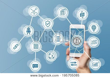 Blockchain and bitcoin concept visualized by mobile phone and blue background