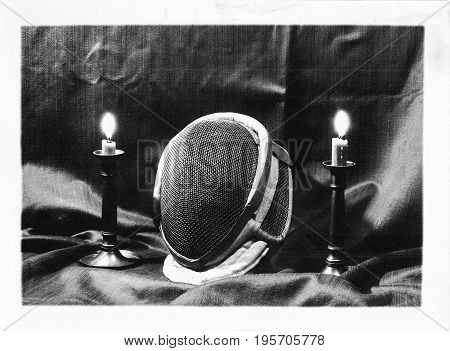 Mystic historic setup with fencing mask and two candles in B W.