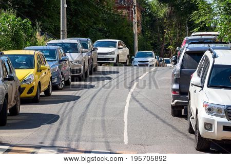Photo of cars parked on both sides of the street