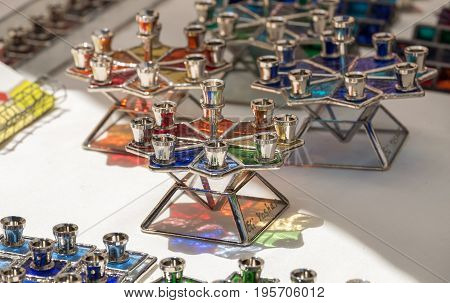 TEL-AVIV, ISRAEL - JULY 07, 2017: Handmade glass hanukkah menorah sold at handicraft market. Israel