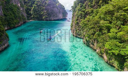 Aerial drone view of iconic tropical turquoise water Pileh Lagoon surrounded by limestone cliffs, Phi Phi islands, Thailand