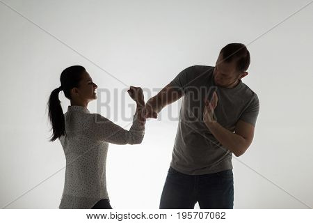 domestic violence, people and abuse concept - angry couple having fight