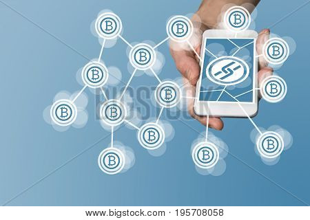 Blockchain and bitcoin concept with hand holding modern smart phone as example for fin tech technology
