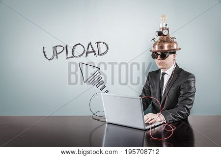 Upload text with vintage businessman using laptop at office