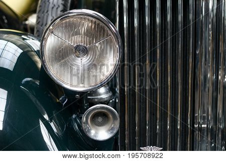 Poland, Otrebusy, 31 March 2017: Frond Light Of Old Car