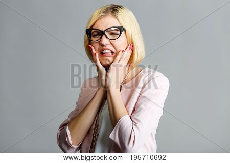 Unhappy woman in black glasses