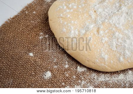 Ball Of Dough For Pizza On The Background Of Rustic
