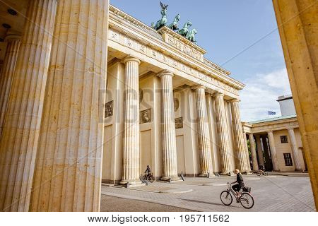 BERLIN, GERMANY - July 07, 2017: View on the famous Brandenburg gates with bicycle rider on the Pariser square during the morning in Berlin city