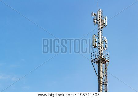 Telecommunication Tower On A Blue Sky Background With Copyspace