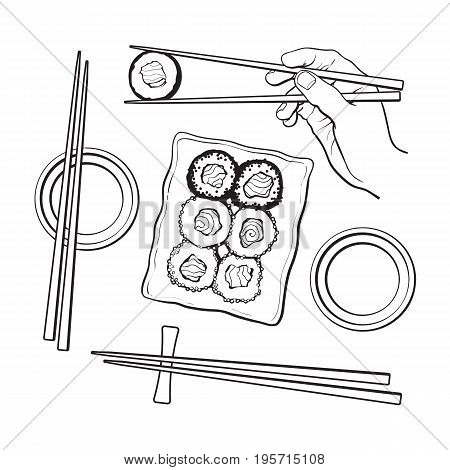 Japanese sushi set, serving plate, hand holding chopsticks, sketch vector illustration isolated on white background. Sushi serving plate, hand with chopsticks, soy sauce bowls, Japanese cuisine
