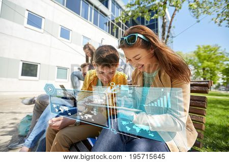 education, technology and people concept - group of happy teenage students with tablet pc computers at school yard