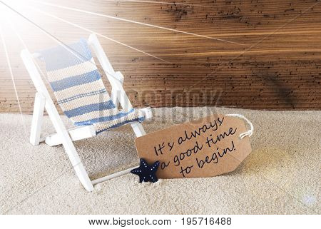 Sunny Summer Label With Sand And Aged Wooden Background. English Quote It Is Always A Good Time To Begin. Deck Chair For Holiday Or Vacation Feeling.